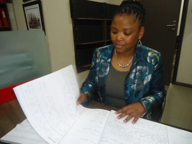 Dr Mbombo browses through the tributes.