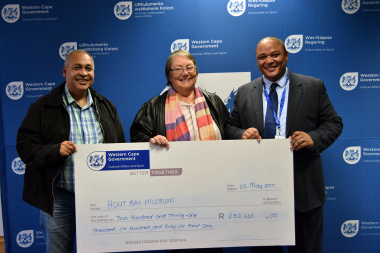 Hout Bay Museum receives their ceremonial cheque from Guy Redman