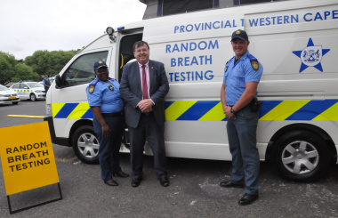 Minister Grant with provincial traffic officers and one of the new Mobile Alcohol Evidentiary Units at the launch.