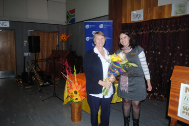 In recognition of the longest serving nurse, Ms Beanca Brown of Metroploitan, handed a bunch of flowers to Ms Martha Maria Conradie who has been serving Tygerberg Hospital's patients faithfully and committedly for the past 44 years.