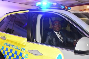 Minister Madikizela in a new highway patrol vehicle.