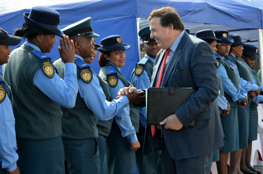Minister Donald Grant greets traffic officers at the official opening of the new Knysna Traffic Centre.