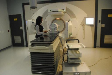 Radiograpger, Ms Jill Meaker demonstrates how the new linac machine works