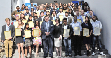 Minister Donald Grant and Ms Jacqueline Gooch with this year's Masakh'iSizwe bursary recipients.