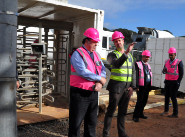 DTPW project leader Gustav Lindemann and Minister Grant at the forensic pathology institute construction site.