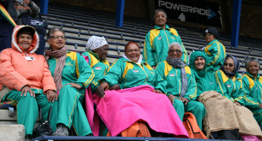 Participants eagerly await the start of the Golden Games despite the wet weather.