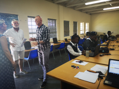 Education leader Trevor Snyman explains the programme to Minister Anroux Marais at Minister Anroux Marais and Coach Sipho Mthembu at the Kwano Cycling Academy at Murray High School in the Bitou Municipality