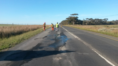 Engineers marking out areas of the existing road to be repaired.