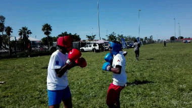 Enthusiastic learners participate in boxing