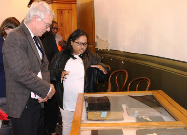 EPWP Intern, Lucretia Petersen at SA Sendinggestig Museum explaining to Minister Cronin about documenting the museum artefacts.