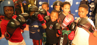 Excited kick-boxers who are expected to benefit from the club.