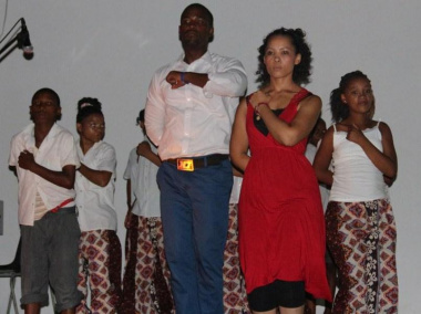 Facilitators and the children performing their final dance
