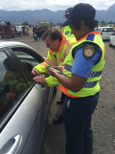 Minister Grant interacts with motorists at the roadblock ahead of the launch.