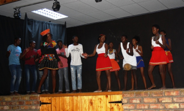 Fezekile Secondary School learners dancing on stage