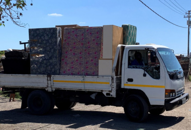 A truck moving a beneficiary's furniture from the Kanana Informal Settlement to Khayelitsha