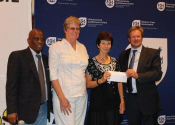 From L to R Director of Sport Promotion at DCAS, Thabo Tutu, Jackie Nicholls and Sue Klein from Overberg Equestrian and Minister of Cultural Affairs and Sport, Theuns Botha