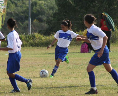 Girls football team in action