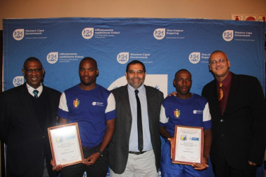 Goliath Munroe, Director Paul Hendricks and Adv Lyndon Boah with co-winners of Indigenous Games, Melikhaya Gxaweni and Sydwell Cekiso