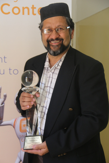 Goolam Mohamed, Acting Director of ECM with the Provincial Star Award for Enterprise Content Management