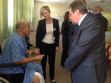 Minister Theuns Botha and Dr Agata Krajewski,Medical Superindent at Groote Schuur Hospital, speak to one of the patients Mr Vernon Scott.