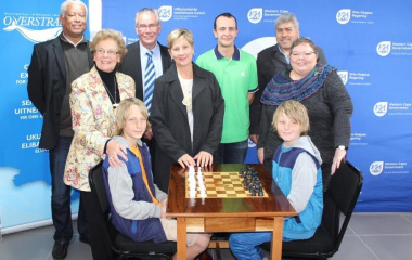 Handing over chess tables to the Library. From left Desmond Lakay, Mayor Nicollete Guthrie-Botha, Stefan Wehmeyer, Minister Marais, Allen Badenhorst, Andre Enslin and Wilna Hooneberg with chess players Dirk and Johan Matthee