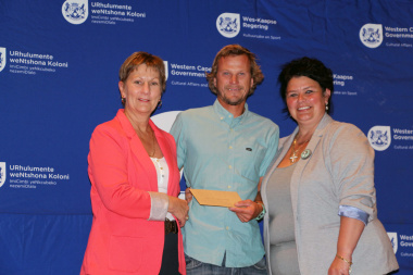 Hannes Stemmet from Cape Winelands Surfing receives their funding cheque