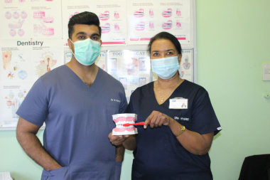 Showing us how to practice good oral health hygiene is Dr Mansoor Mohamed, dentist at Hanover Park CHC with Silvertown Clinic's Oral Hygienest, Tania Woodman.