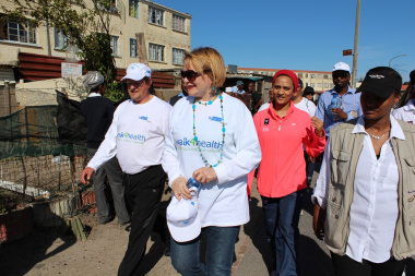 Western Cape Minister of Health Theuns Botha and Premier Helen Zille join Hanover Park residents on a community walk.
