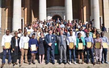 Minister Grant and Ms Gooch with the Masakh'iSizwe bursary recipients.