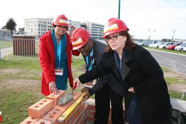 Dr Anita Parbhoo (Medical Manager), Dr Matodzi Mukosi (CEO) and Sandra Roodt (Nursing Manager) lay bricks at the symbolic brick-laying event.