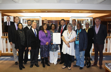 HOD Brent Walters and senior DCAS staff members with the pledge reiterating the departments commitment to gender transformation