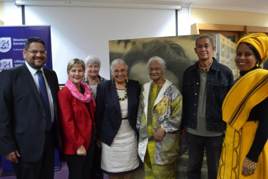 HOD Brent Walters, Minister Anroux Marais, Chief Director Hannetjie du Preez and Director Nikiwe Momoti with friends and family members of Dulcie September