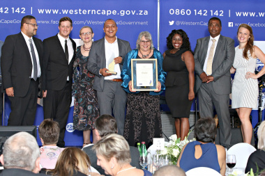 HOD Brent Walters and the After School Game Changer Team receive the gold award from Premier Zille