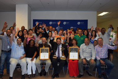 HOD Walters celebrating the awards with senior managers and various staff members