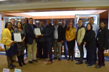 HOD Brent Walters receiving the EPWP awards with the DCAS senior managers in attendance