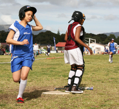 A young participant scores a home run for Cederberg Primary School.
