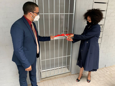 Minister Sisulu and Minister Simmers cutting the ribbon at Anchorage