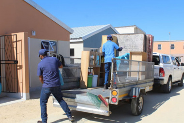 Trailer being unloaded as beneficiaries are moving in