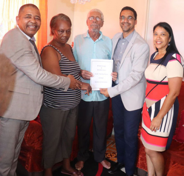 Mr. Karel Visagie receives title deed from Minister Simmers