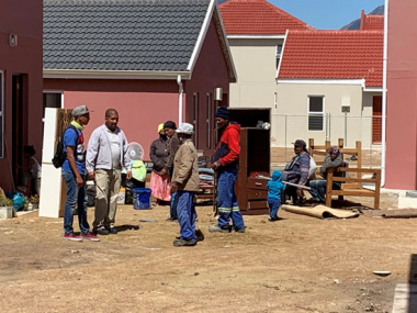 Vlakkeland residents moving in to their homes