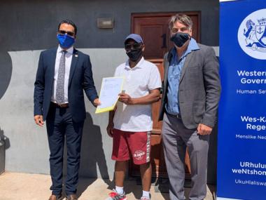 Western Cape Minister of Human Settlements, Tertuis Simmers, Mr Isak Bester (59) and Saldanha Bay Executive Mayor, Alderman Marius Koen.