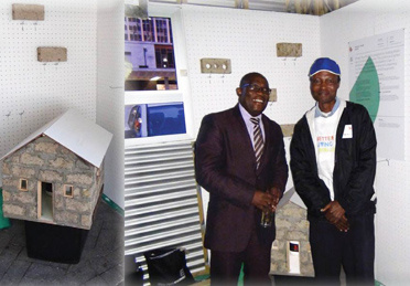 Minister Madikizela with inventor of the Prickly Pear Brick, Vusumzi Makhatshana. The model on the left is built with this brick.