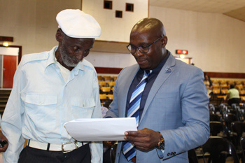 Minister Madikizela with 107-year-old, Mr Seleku James Xontana who received his title deed on Friday