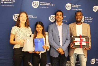 1st Runner-up Annabela Bekker, 2nd Runner-up Cynthia Augustine, Minister Simmers and Winner Anesu Malisa