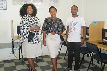 Nomawethu Kosani, Zizipho Magqaza and Thabiso Gongo are ready to assist at the Ilingelethu e-Centre.