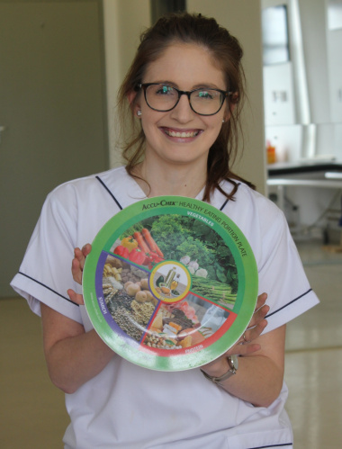Dietician, Darinka Theron with an example of foods for a healthy meal and their portions.