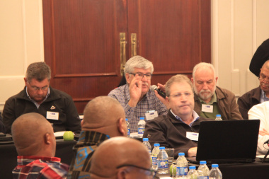 Municipal officials engaging with other participants during a panel discussion.