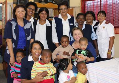 Dr Schumann and health staff at Juweeltjie Crèche