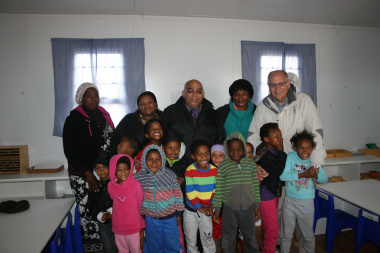 MEC Fritz pictured with staff and learners of Klippie Kids Early Childhood Development Centre