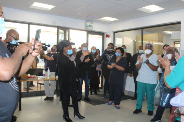 Staff at Victoria Hospital welcome Minister Nomafrench Mbombo with a song